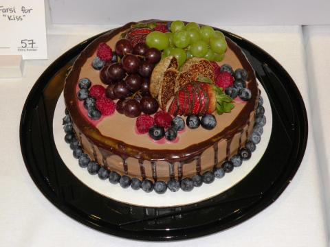 Chocolate cake decorated with fresh fruit at Logan's Valentine Chocolate Festival